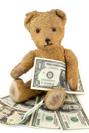 Isolated Teddy bear with Dollar Bills on white background photo