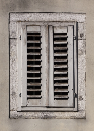 Closed white old wooden window  photo