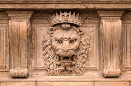 Beautiful old stone lion head motive photo
