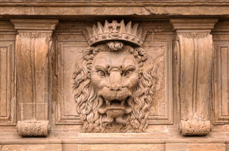 heads old building facade: Beautiful old stone lion head motive