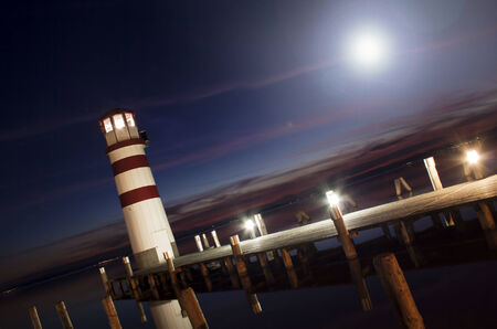 Beautiful lighthouse lighting at night