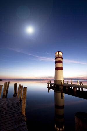 Beautiful lighthouse at night photo