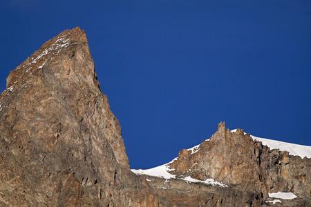 winter blues: Snowy rocks in the blue sky - Pelvoux Mountain, France