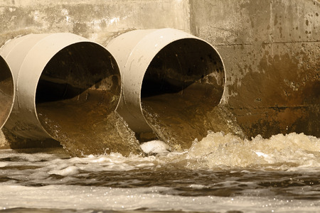 polluted river: Toxic water running from sewers to the environment