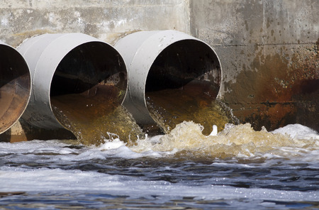 sewer water: Toxic water running from sewers to the environment