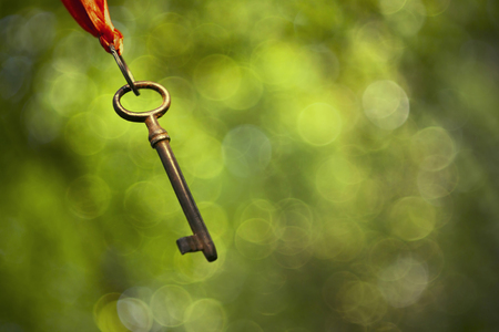 self realization: Old rusty key hanging in the air