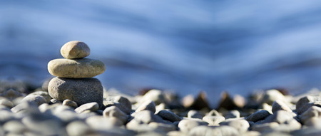 therapy group: Relax Zen stones on the sea beach Stock Photo