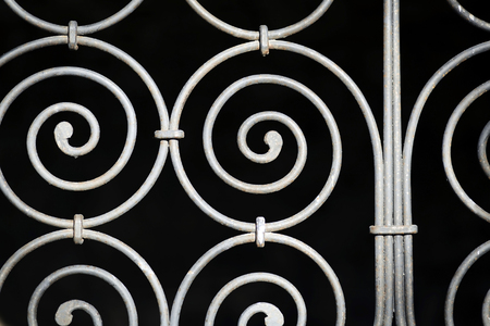 iron bars: Details of an old ornamental iron fence