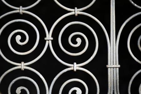 rejas de hierro: Detalles de una antigua valla de hierro ornamental