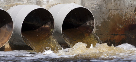 toxic water: Pollution - website banner of toxic water as running from sewers to the environment Stock Photo