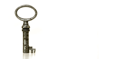 Key standing on a white background with copy space
