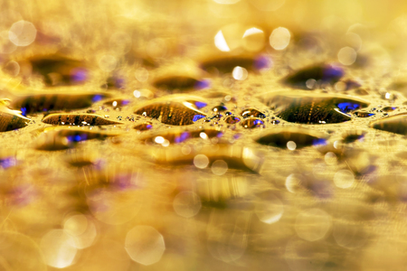 Golden glittering water drops - abstract background idea