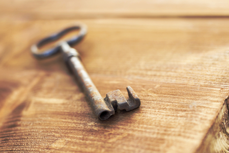Solution, life coaching concept - key on a wooden background Foto de archivo