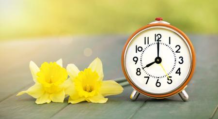 Good morning concept web banner of yellow flowers and orange good morning concept web banner of yellow flowers and orange alarm clock stock photo mightylinksfo