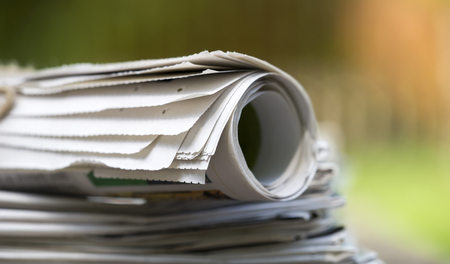 Business, daily news concept - stack of newspapers close-up Stockfoto