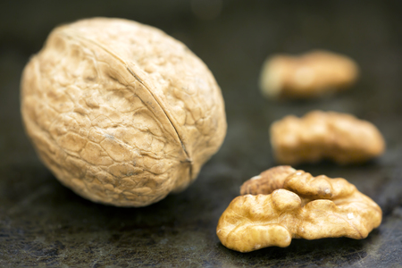 Healthy food concept, walnut with and without shell, closeup