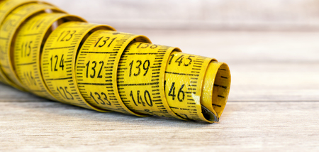 Weight loss concept - website banner of an old tape measure with copy space