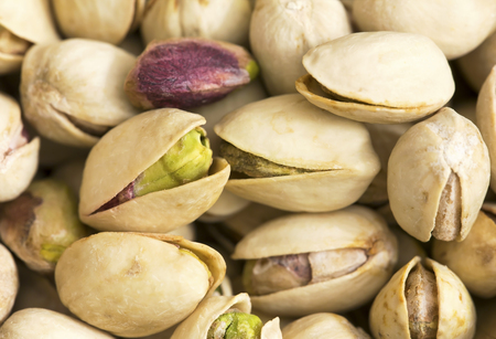 Dried pistachio nuts with shell closeup Imagens - 122800729