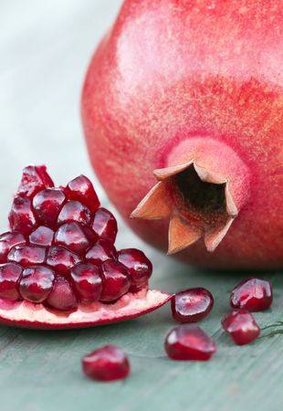 Pomegranate, natural antioxidant, diet, vertical background with copy space