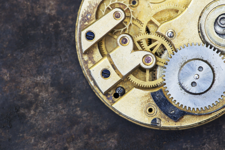 Vintage clock close-up, time mechanism with metal gears