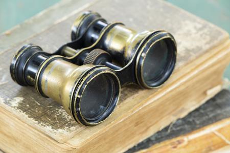 Binoculars on books, searching wisdom, knowledge