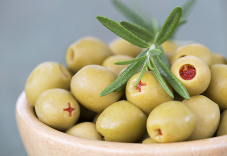 Fresh healthy green olives with rosemary closeup