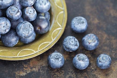 Healthy eating, blueberries natural antioxidant fruits, snack foods on metal grunge background 写真素材
