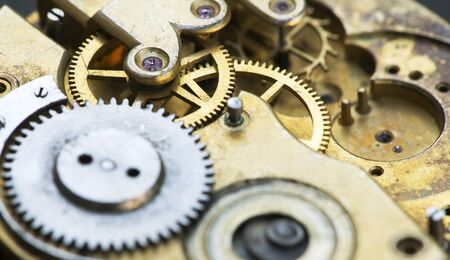Gears of a vintage metal business clock watch close-up, time mechanism web banner 写真素材