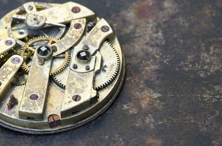 Business pocket watch, clock gears close-up, time mechanism with metal gears, top view 写真素材