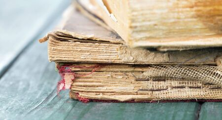 Closeup of old, antique books on wooden table, web banner