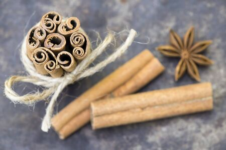 Organic healthy spices, cinnamon sticks with star anise, top view