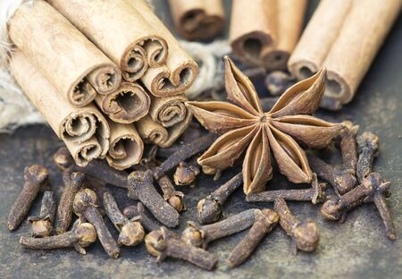 Organic healthy spices, cinnamon sticks with star anise and cloves, top view
