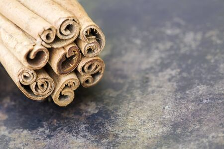 Cinnamon sticks closeup, organic healthy spices, background with copy space