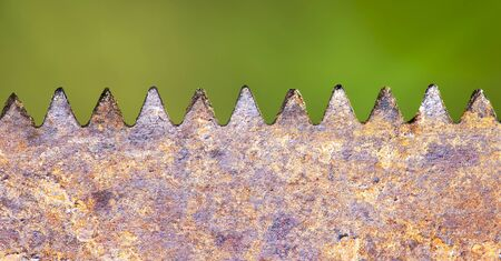 Hand tool, equipment - web banner of a rusty saw blade close-up