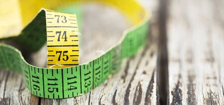 Weight loss, diet concept - web banner of a tape measure with copy space