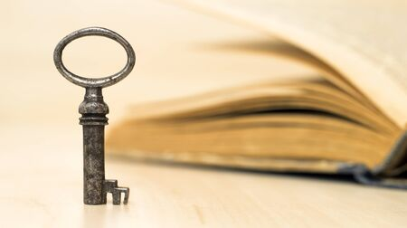 Web banner of a solution key and old book with copy space Banco de Imagens