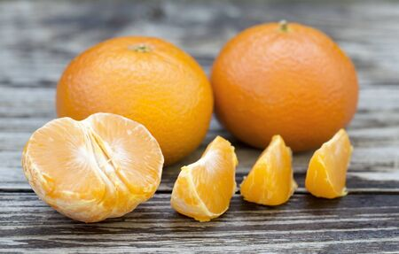 Vitamin c concept, fresh yellow mandarins on wooden background Stock Photo