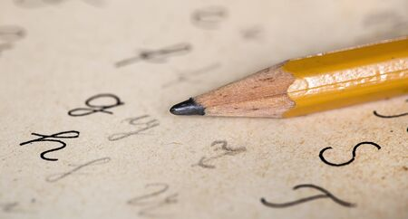 Back to school concept, pencil tip with handwritter abc letters, close-up