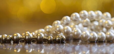 Beautiful shiny white and golden pearls, necklace jewelry web banner