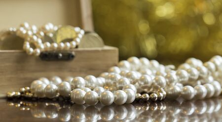 Jewelries, white pearls with treasure chest on golden background, luxury, wealth concept, web banner
