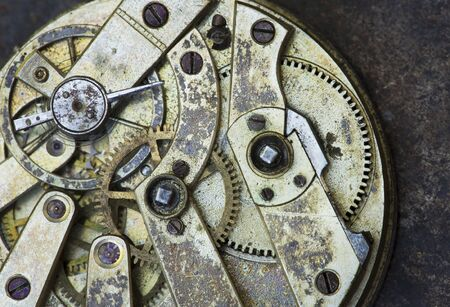 Gears of a vintage metal business clock watch close-up background, time mechanism, timing concept Stock Photo