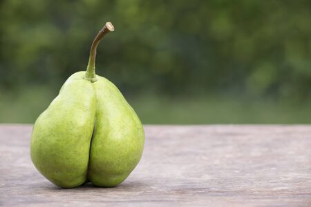 Cellulite food, diet concept, pear looks like a bottom, background with copy space