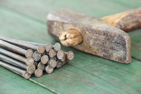 Vintage work tool, hammer and nails. Closeup, macro view