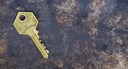 Solution, success golden key on grunge metal background, web banner with copy space