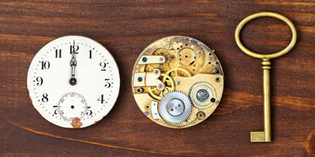 Watch and clockwork with gold key, time management or deadline, countdown concept. Web banner.