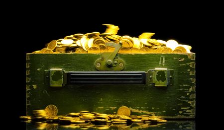 Riches, gold coins in a chest isolated on black photo