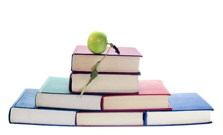 apple on stack of books isolated on white background photo