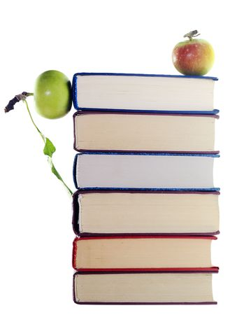 apples on stack of books  photo