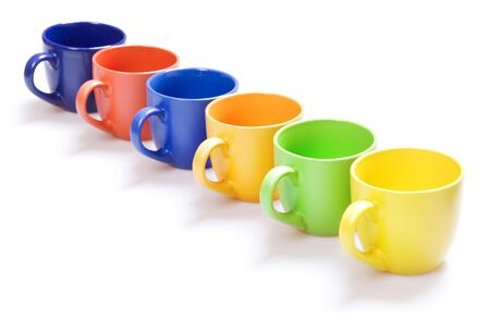 Color cups isolated on white. Stock Photo