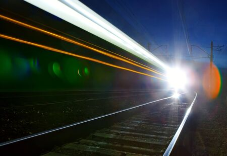 abstract of fast train passing by photo